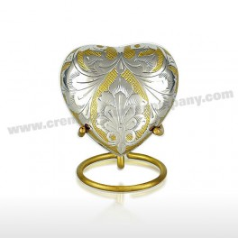 http://www.cremationurnscompany.com/1049-thickbox_default/gold-and-silver-3inch-heart.jpg