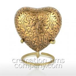 http://www.cremationurnscompany.com/1581-thickbox_default/autumn-gold-3inch-heart.jpg