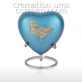 http://www.cremationurnscompany.com/1592-thickbox_default/pewter-butterfly-3inch-heart.jpg